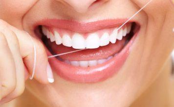 Cómo usar hilo dental. Paso 1